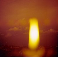 View through candle flame, Forestville, Dec 1977